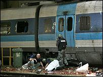 Israeli police examine scene of Haifa missile impact at rail station