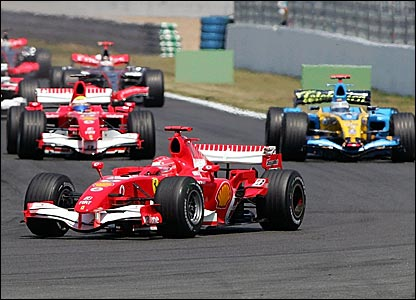 Michael Schumacher leads from Ferrari team-mate Felipe Massa and Renault's Fernando Alonso