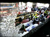 Rescue workers wheel a victim from the site of a rocket attack by Hezbollah militants at the train station in the northern Israeli city of Haifa
