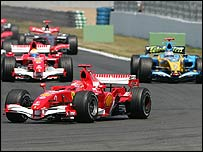 Michael Schumacher leads Fernando Alonso (right) and Felipe Massa (left)