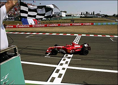 Michael Schumacher crosses the finish line to win the French Grand Prix