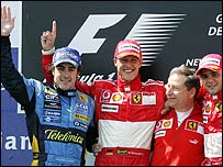 Fernando Alonso (left), Michael Schumacher (centre), Jean Todt and Felipe Massa (right)