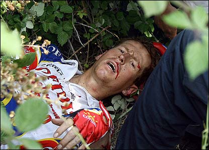 Belgium's Rik Verbrugghe lays on the ground after a crash