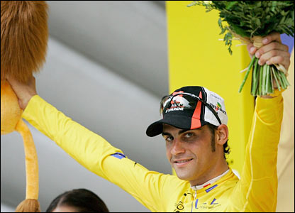 Oscar Pereiro of Spain celebrates his yellow jersey as overall leader on the podium
