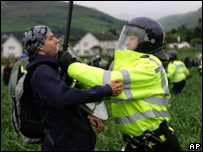 A UK police officer and G8 protester