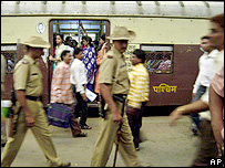 Police on patrol in Mumbai railway station