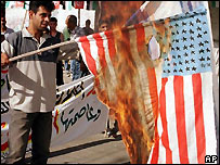 A protester burning the US flag in the Palestinian territories