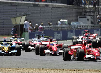 Michael Schumacher (right) leads from Felipe Massa (behind) and Fernando Alonso (right)