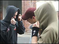 Hoodie-wearing youths