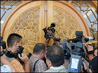 Reporters outside the office of the Syrian foreign minister