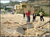 Bomb crater in main road in Nabatiyeh