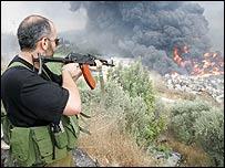 Hezbollah fighter at scene of explosion near Beirut