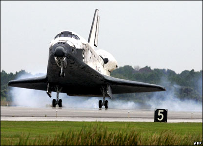Space shuttle Discovery touches down at the Kennedy Space Center