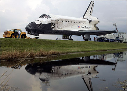 Space shuttle is towed from the runway
