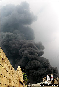Smoke rises from an Israeli strike in Beirut on 17 July 2006