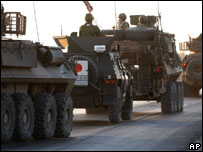 Japanese coaliton troops in convoy outside their base before a handover ceremony, Thursday, July 13, 2006