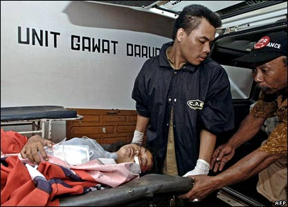 A woman injured in the tsunami is treated in hospital