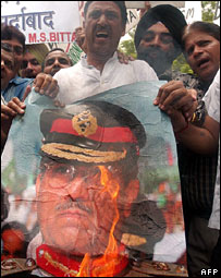 Indians burn a poster of President Pervez Musharraf in Delhi