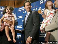 Senator Sam Brownback (centre) with parents and children involved in the stem cell debate