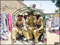 Pakistani paramilitary troops ride in a vehicle as they patrol a market in North Waziristan tribal area