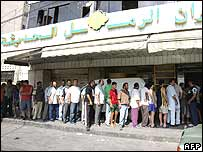 Queues form outside a bakery in Tyre, southern Lebanon