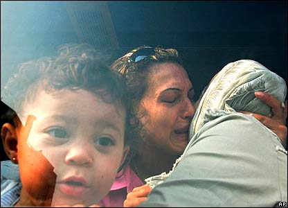 A Swedish family weep as they are evacuated from Lebanon