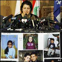 Meyssoun Akhras with photos of her relatives killed in Lebanon