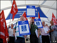 Peugeot workers protest outside the London Motor Show