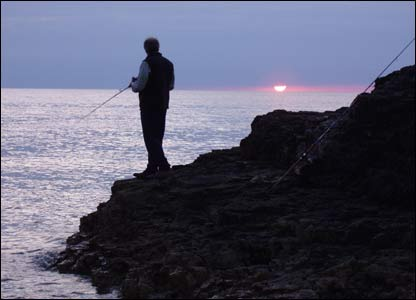 Andy Lewis fishing for mackerel off the Great Orme, Llandudno, taken by his brother Dave.