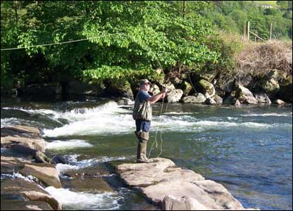 Michael Jones battling with the fish on the river Neath, taken by his brother Phillip Jones
