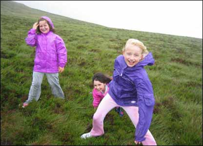 Picture of Alice, Melissa and Catrin climbing the Berwyn mountains in a gale (Dan Hitchcock)