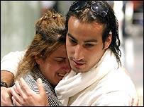 Man hugs a German woman who has fled Lebanon