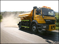 Gritter lorry spreads sand on heat-damaged road in Cumbria