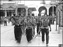 Fascist volunteers march through Burgos, Northern Spain