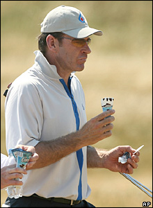 Golfer Nick Faldo eats an ice cream in practice for the Open