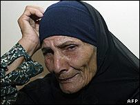 Lebanese Shia woman who fled her country due to the Israeli bombardment cries at a makeshift refugee centre in Damascus