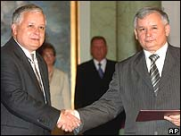 The Kaczynski brothers after Jaroslaw, right, was sworn in as prime minister on 10 July 2006
