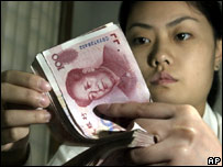 Chinese bank worker counts notes