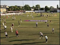 Supporters play on the outfield between innings