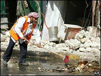 Man sweeps up bomb damage