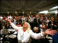 Delegates celebrate a musical performance at their summit. (Photo courtesy Christians United For Israel) 