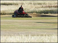 The ground staff tend to a very dry and frazzled Hoylake