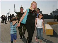 Maria Noujeim and her children Jessica and Mario disembarking from HMS Gloucester