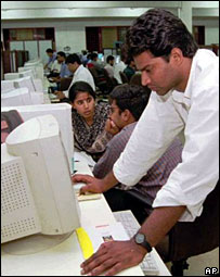 Indians with computers in an office