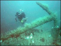 Diver with the anchor of HM Fireship, Firebrand