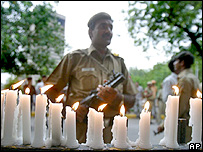 Policeman by candles lit in memory of the blast victims