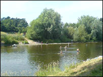 People swimming in the river at Usk