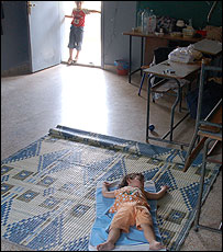 Child lies on floor in Baabda School