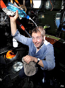 Andy Christie of the Severn Valley Railway tries to cool down on his engine in Kidderminster