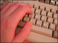 Person using computer keyboard